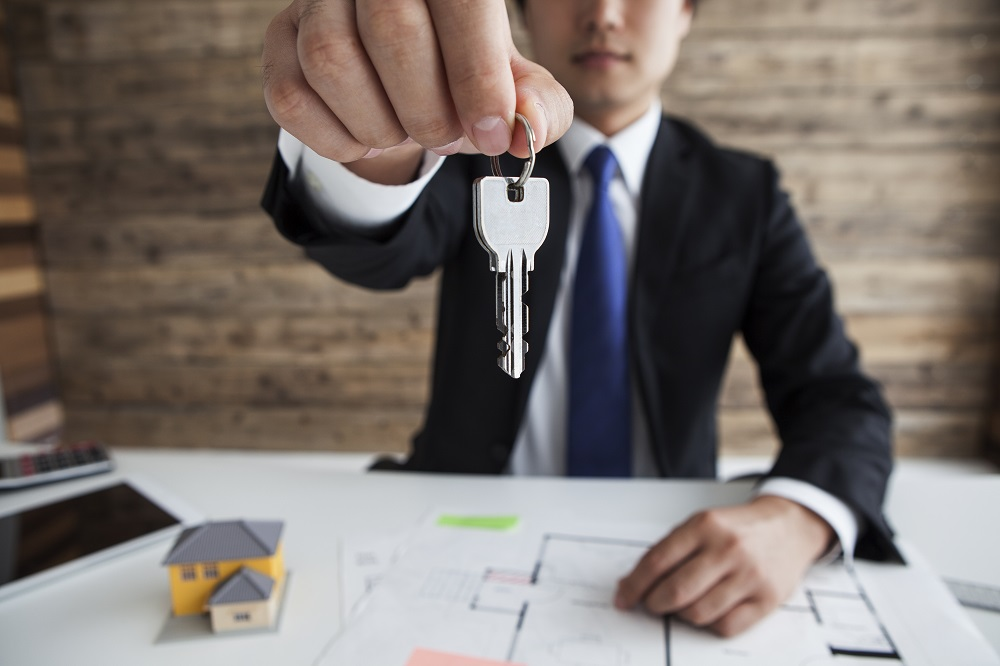 Real Estate Property Manager Holding Keys to New Home