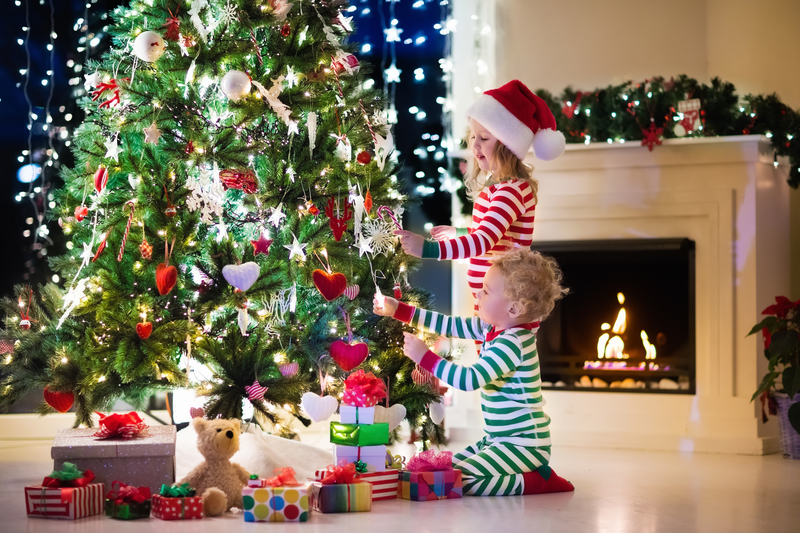 Young Children Decorating Christmas Tree at Home 2016