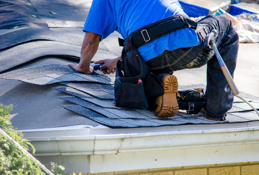 Man Fixing Roof for Property & Home Maintenance