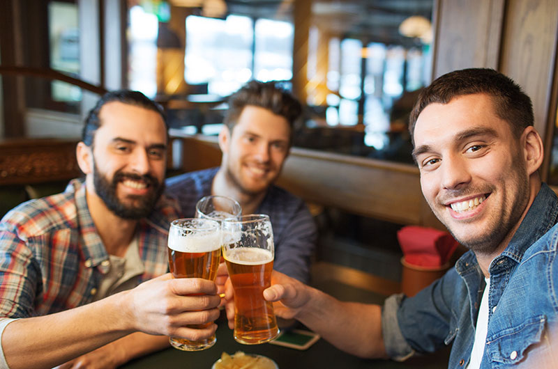Men Drinking Beer at New Helvetia Brewing Company in the Bay Area, CA