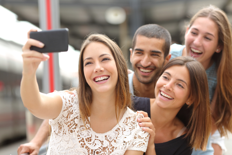 Millennial Friends Taking a Selfie at Train Station