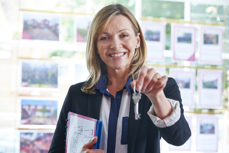 Female Property Manager Holding Keys